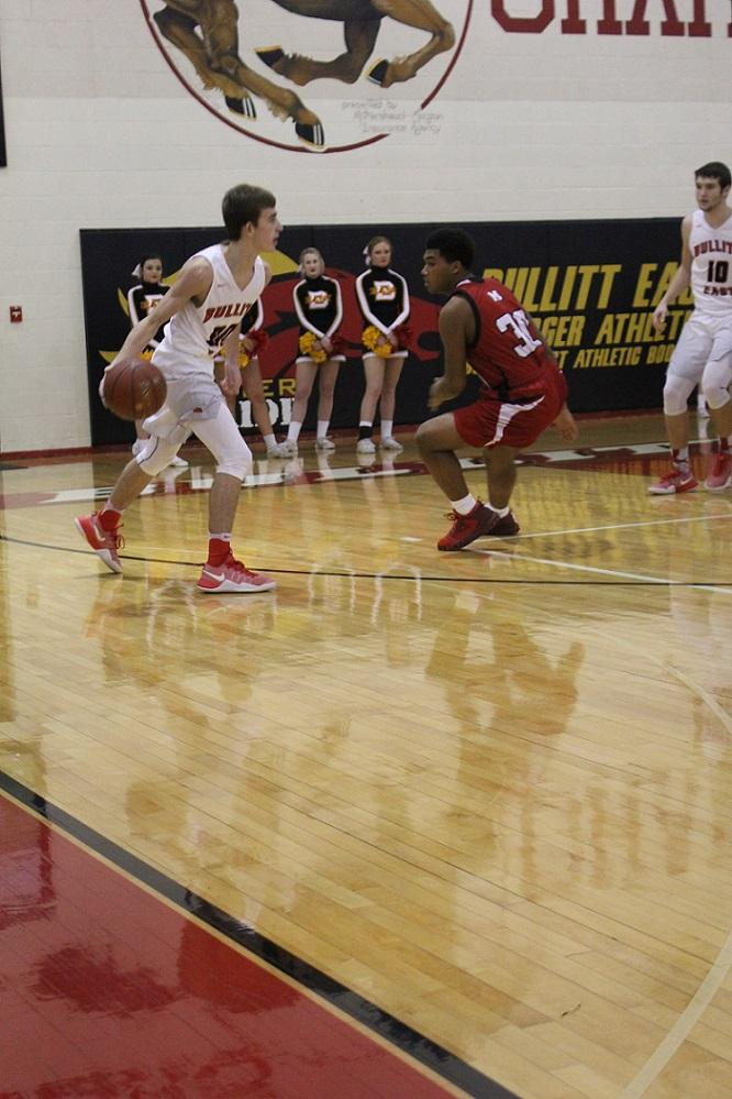 Point guard Luke Ezell brings it back out to set up the offense for the Chargers.