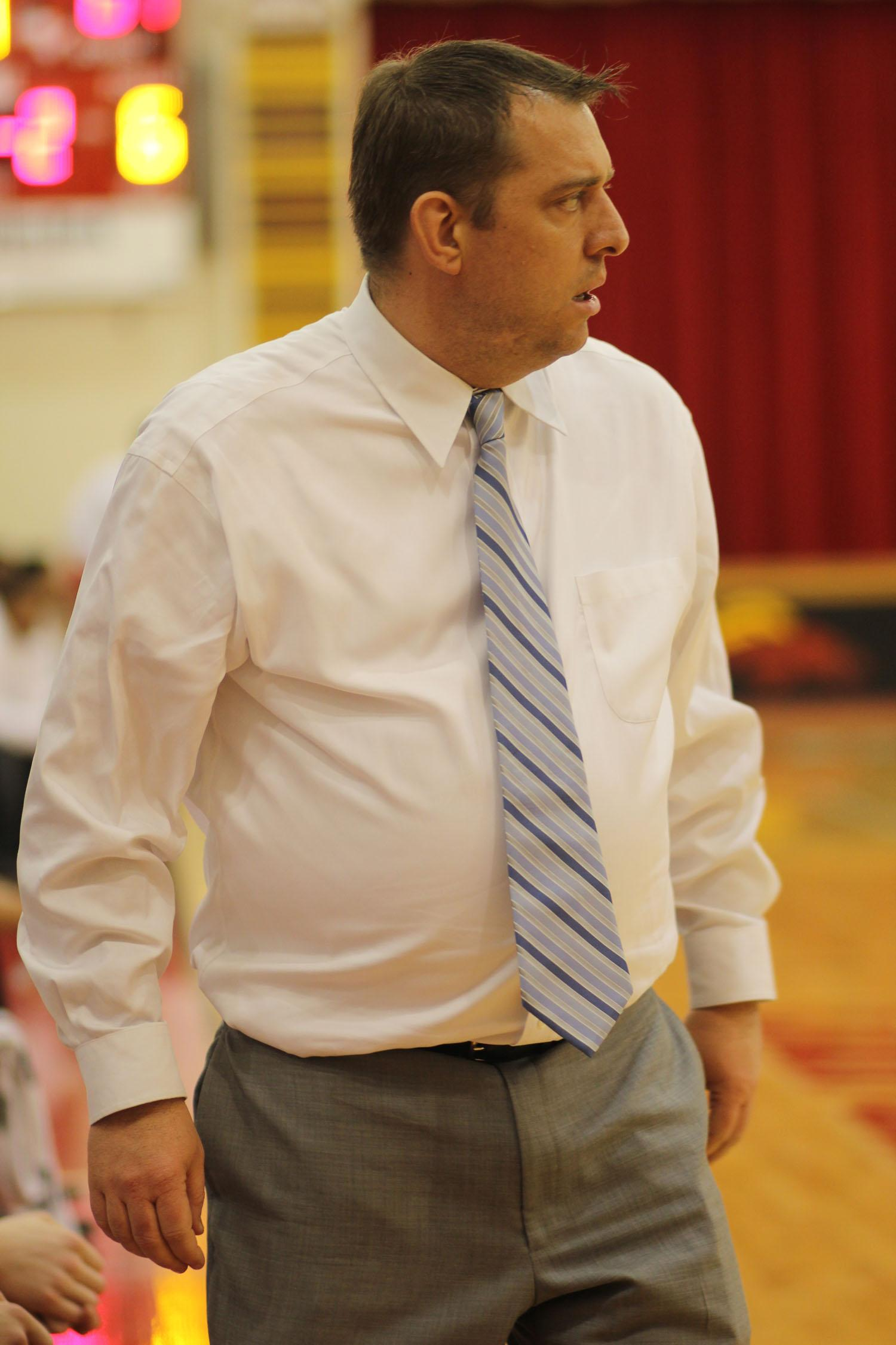 Head Coach Jason Couch patrols the sidelines during an intense district game against J-Town.