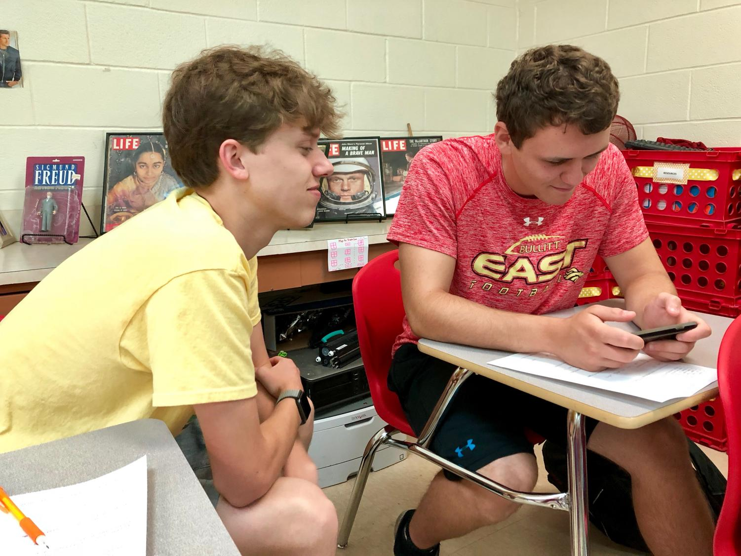 Many seniors find their days more and more open. Seniors Tristen Preston and Clay Wiliams spent their morning relaxing and talking after finishing a short assignment for AP Psychology.