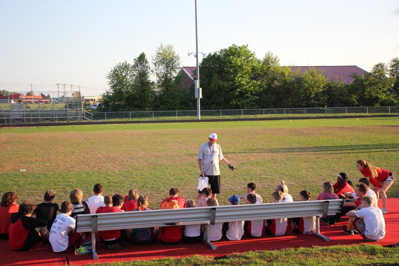 Coach Lenny Raley giving the team a pep-talk before a meet.