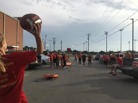 Before the first football game, students gathered in the parking lot for the first Redzone Rowdies Rally.