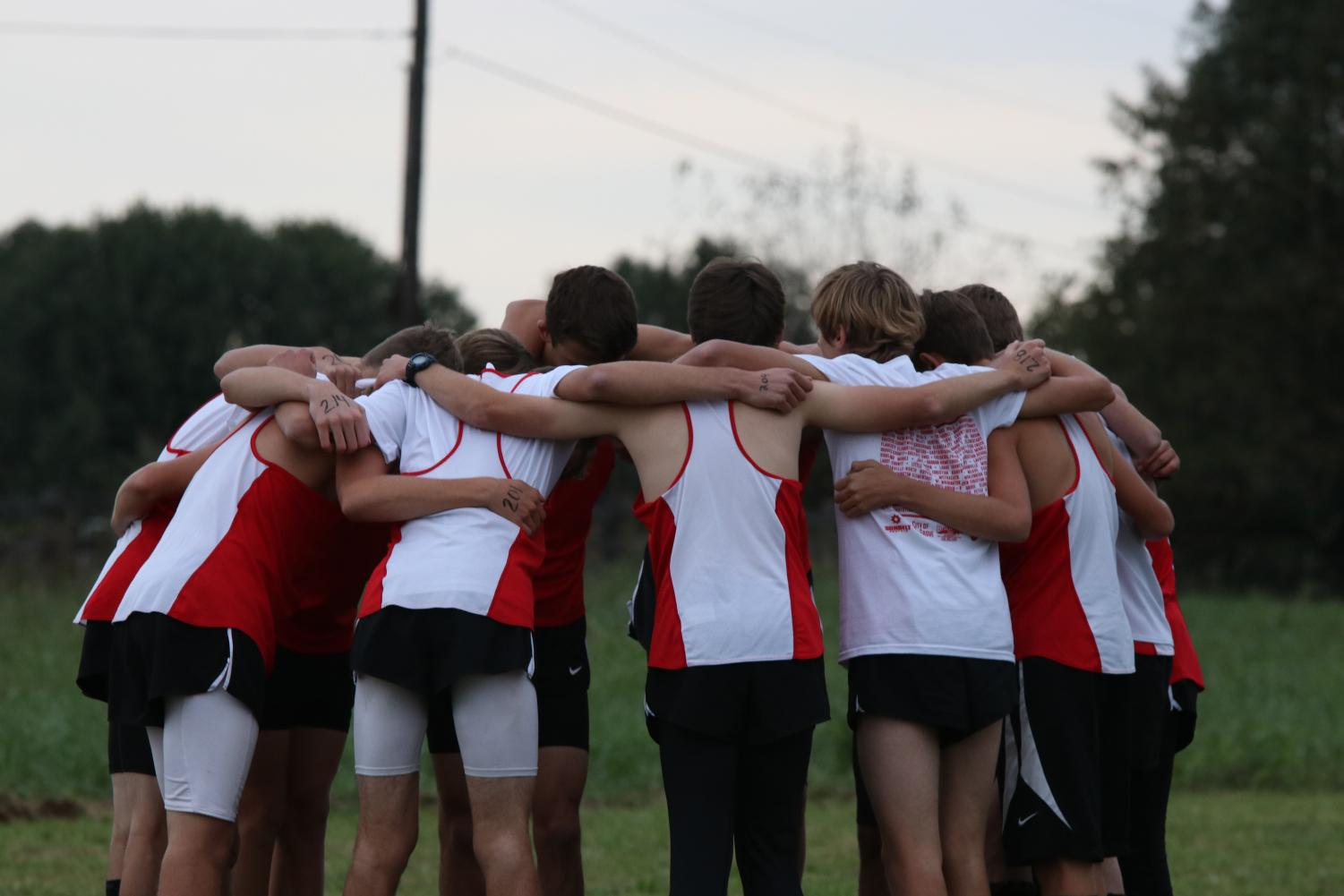 Boy runners huddle up for a pre-run pep talk.
