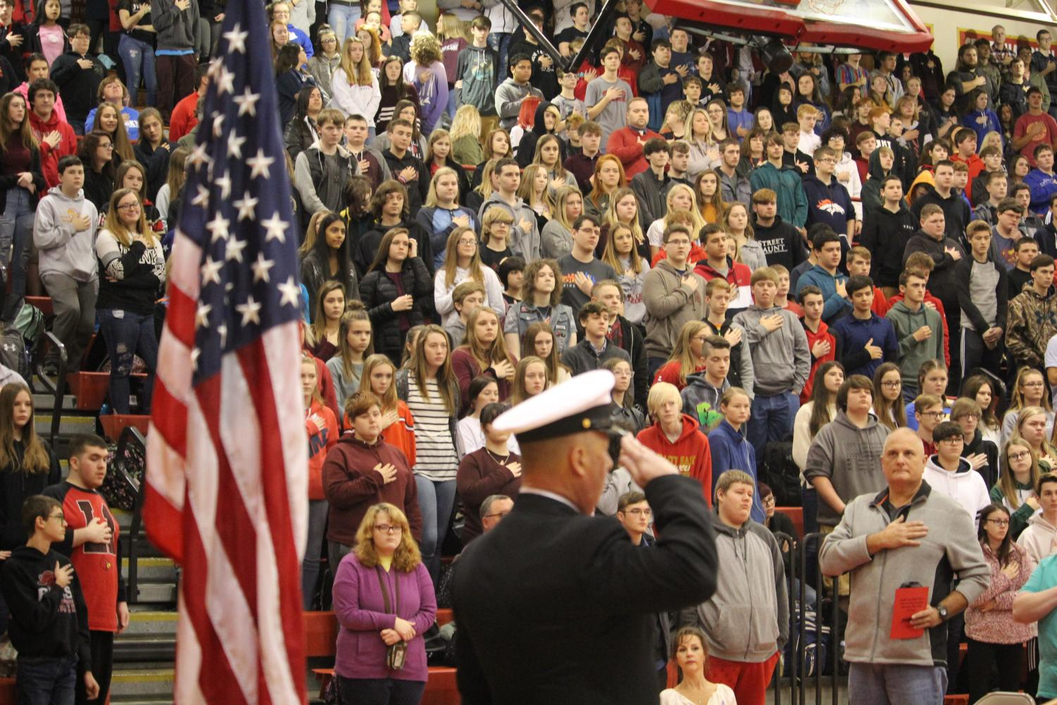 Master Sergeant Chief Charles Ballard sharing his speech about his own and others' experiences serving in the military as students listen attentively. The speech was intended to be one of the ways that Vice Principals Cyndi Bell and Tim Ridley could emphasize the importatance of veterans during the assembly.