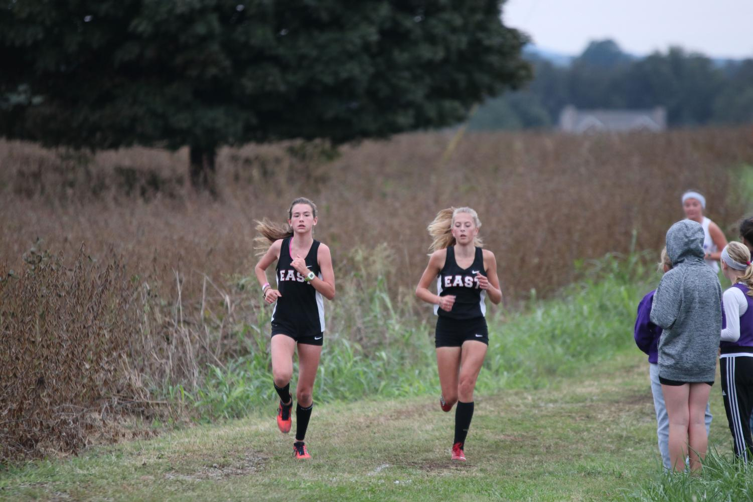 Freshman Mia Maguire and Sophomore Emily Tinelli are running into the next cross-country season.