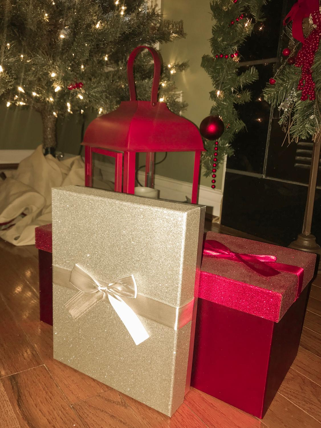 Gifts are placed under the tree in preparation for gift exchanges.