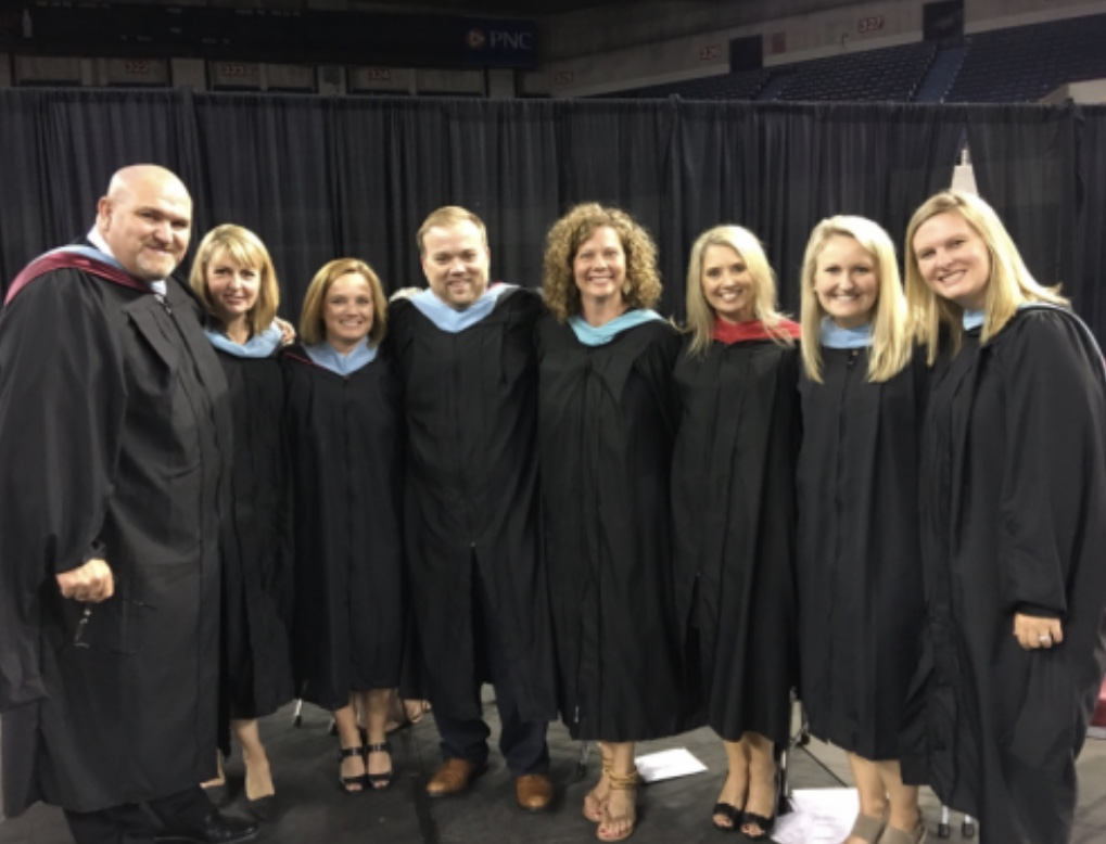 Bell with the administrators and other co-workers on graduation. Bell has developed good relationships with everyone at Bullitt East High School.
