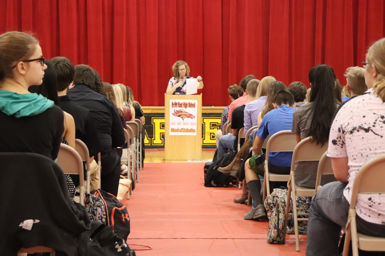 Guidance Counselor Dana Steinmetz announces awards for academic achievement.