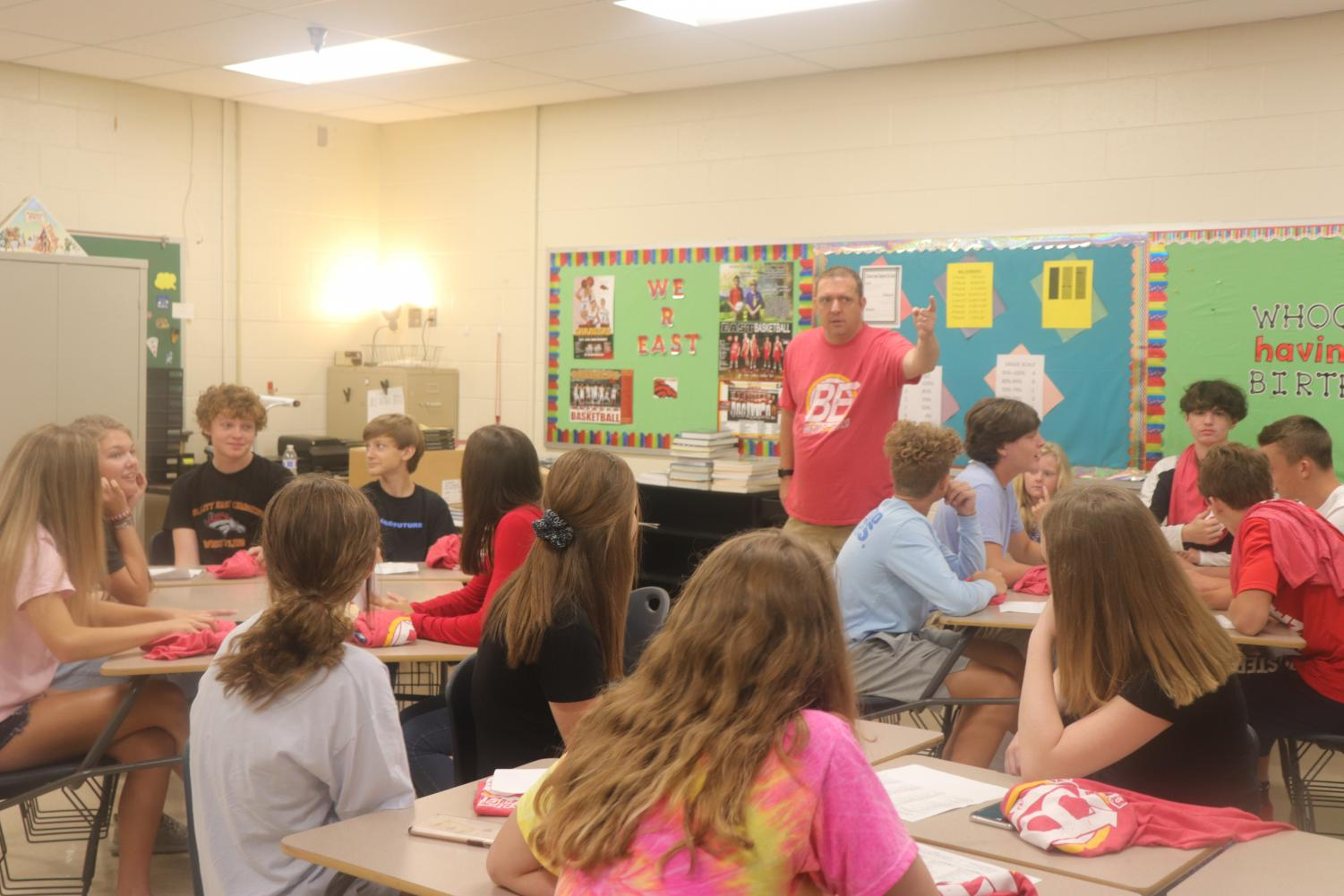 Algebra teacher, Jason Couch prepares his  incoming students by explaining his expectations for them. This class was his fifth period class in which students were listening to his instructions intently.