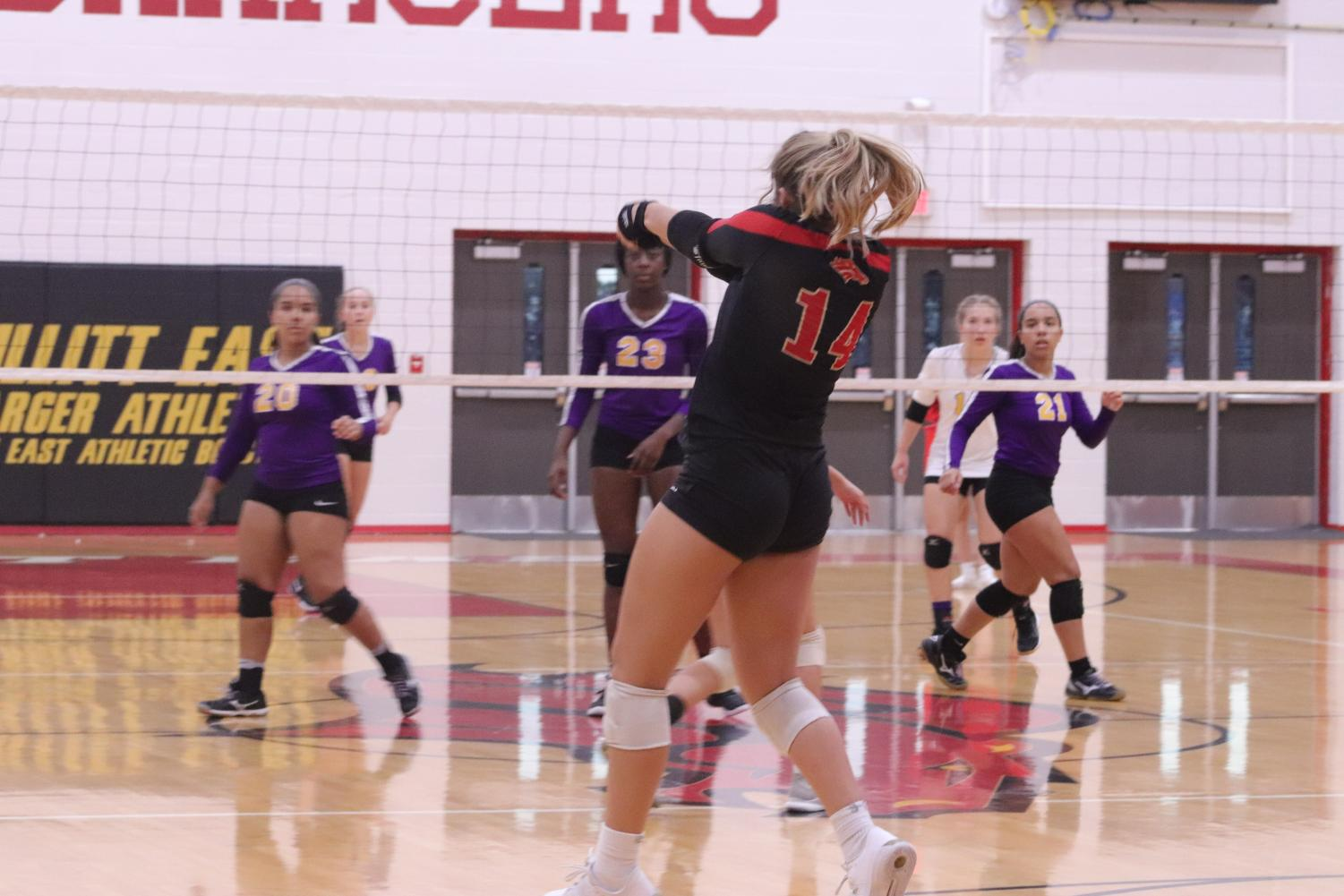 Junior Emily Popplewell passes the ball over the net. The Lady Chargers won this game against Bardstown High School. Senior Halle Key said,