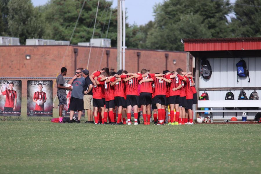 The boys soccer team huddle together before the game against Fort Knox.