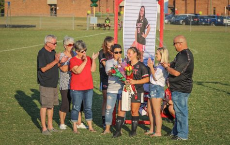 "Surrounded by family while her favorite memory and advice to younger teammates was being read off, senior Brookelynne Montague stood surrounded by family during the senior night ceremony. All of the seniors were lined up as they were recognized one by one. ""It felt so unreal to be standing there in front of my teammates, classmates, family, and friends as we were being called one by one to be recognized. I guess you could say it truly was a bittersweet night,"" said Montague."