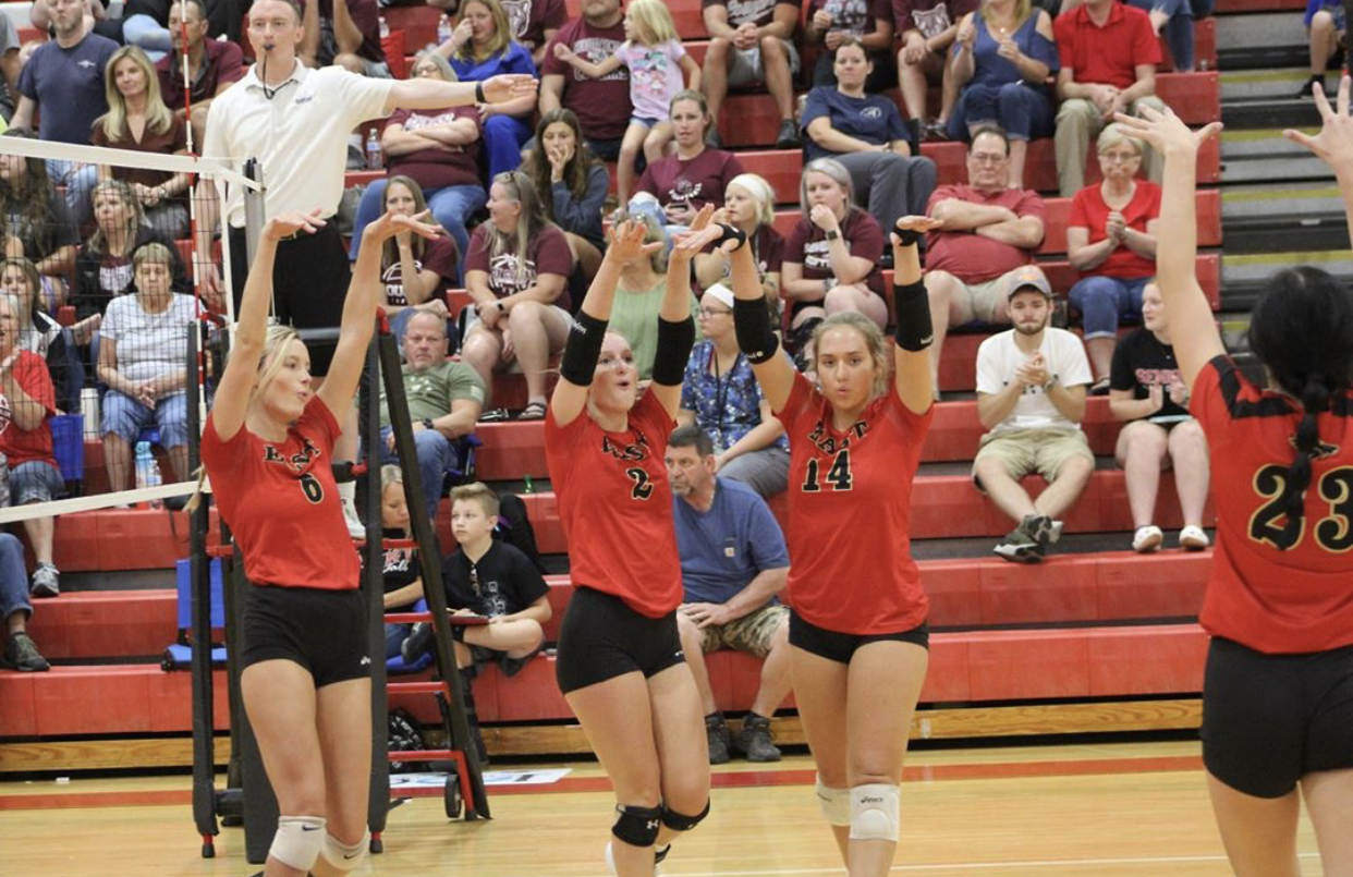 From left to right: Senior Carissa Kimball, senior Julia Kromenacker, junior Emily Popplewell, senior Halle Key. The team celebrates after having a good hit. Popplewell said,