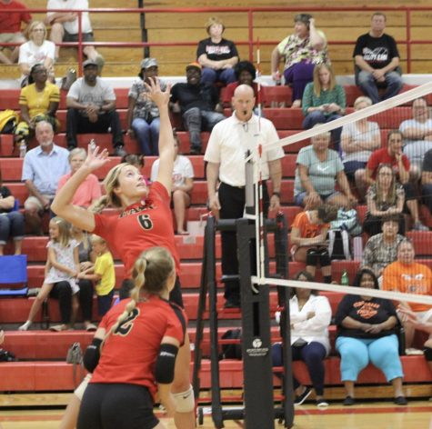 Senior Carissa Kimball goes up to spike the ball. The team won this game against the Fern Creek Tigers 3-0.