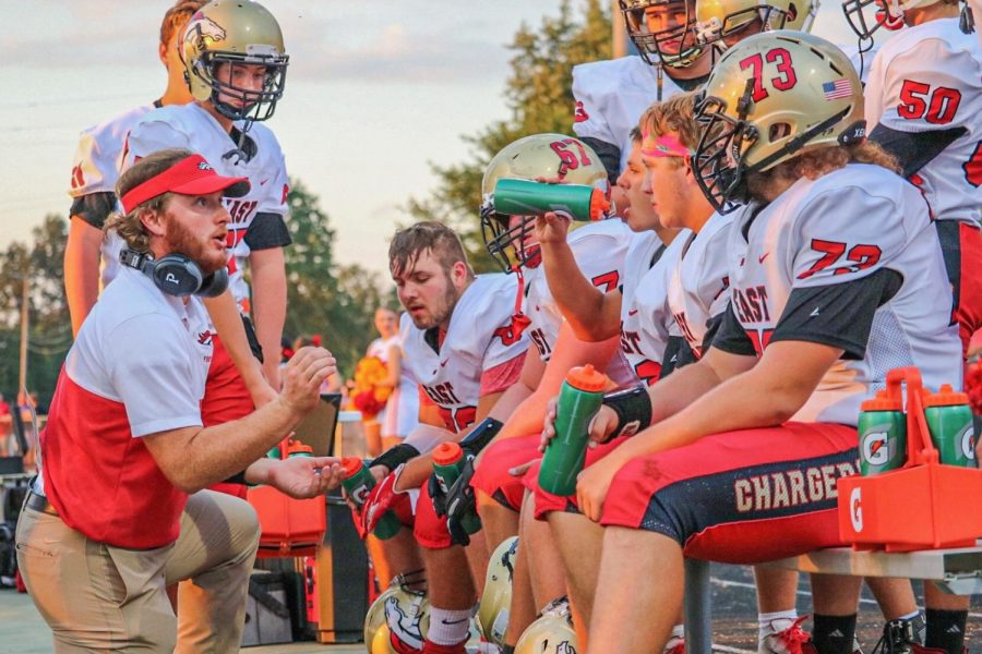 Coach+Keegan+Kendrick+is+giving+the+offensive+line+a+talking+to.+The+Chargers+line+made+holes+for+the+team+to+gain+221+rushing+yards.+