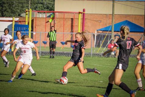 "Charging in to kick the ball, senior Chloe Holt scores the first goal. The Lady Chargers played against Atherton with the final score being 4-0. 2. ""It felt good scoring the first goal because once you get the first goal then it makes the whole team play harder,"" said Holt."