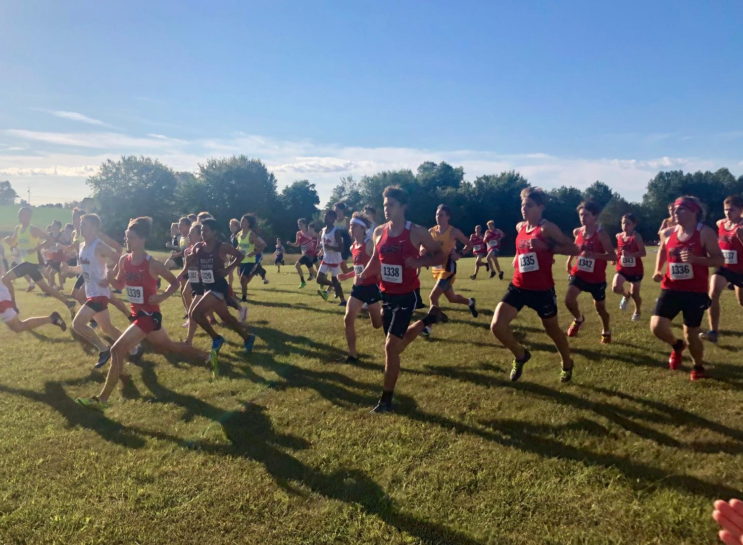 The cross country boys blast off the finish line and take late leads early in the race. They are happy with their past performances and continue to push themselves.