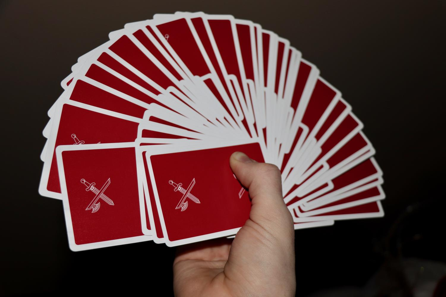 "Sophomore Brodie Curtsinger doing a cardistry move called a ""giant fan"" with the Blood Red Kings Version Two deck of cards by card creator and magician Daniel Madison."