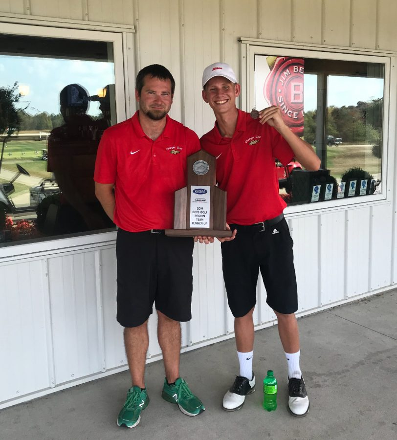 Coach+Kyle+Downs+and+senior+Aiden+Robison+holding+trophy+of+second+place+from+regionals.+The+boys+golf+team+placed+second+at+regionals+on+Oct.+1%2C+against+12+other+teams%2C+and+Robison+and+junior+Thomas+Bryan+earned+a+spot+in+the+state+tournament.+%E2%80%9CThomas+and+I+are+going+to+get+prepared+for+state+by+playing+a+ton.+We+want+to+show+the+state+that+Bullitt+East+has+some+great+golfers%2C%E2%80%9D+said+Robison.+
