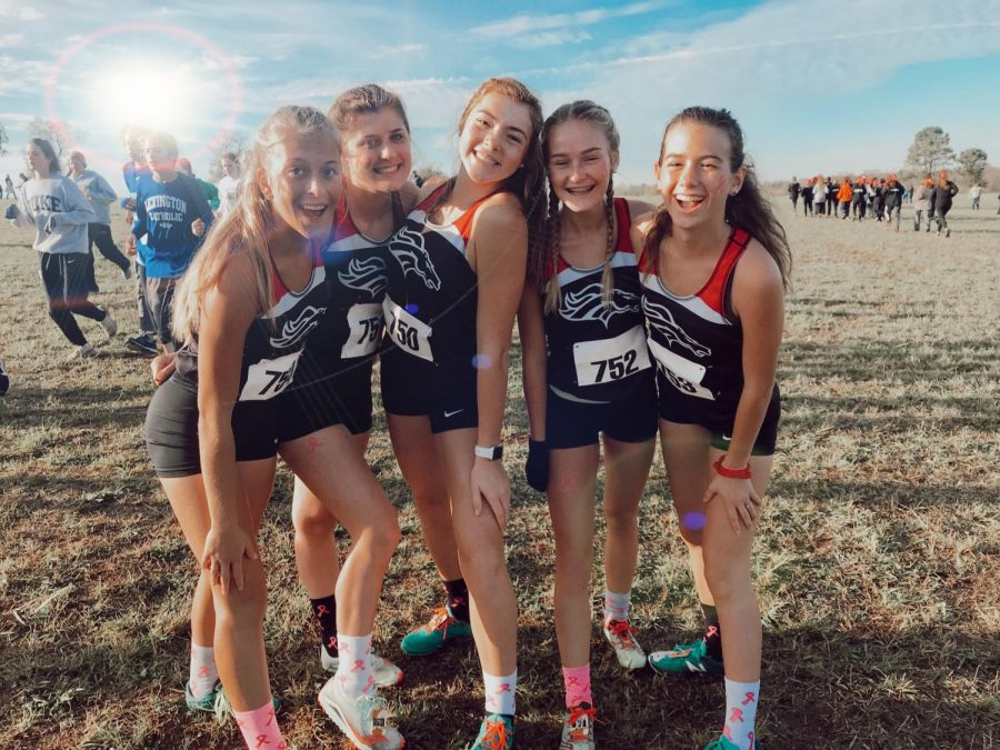 The cross country girls pose after a successful meet. Four of the girls finished in the top 35 in Saturday's race.