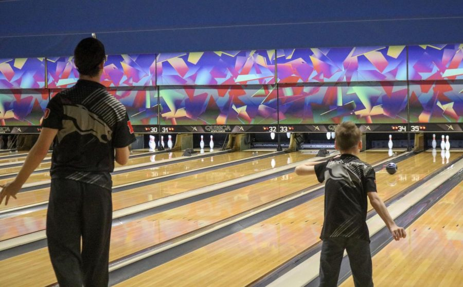 """Junior David Boyer and junior Zachary Compton bowling at the Unified Regionals tournament. Boyer, Compton, sophomore Austin Hale and senior Dylan Young bowled as two separate teams, at the Unified Regionals tournament, and Compton and Hale actually ended up winning the whole tournament. """"I have a tender spot for those kind of kids. You know, our school is highly recognized as one of the top schools in the United States for being involved with unified programs, and so, really two good kids. David is very high strong and got a lot of energy; loud and a lot of school spirit. And Zach's kind of the opposite; really quiet, and doesn't say a lot. But they're both great kids. They did a really good job bowling,"""" said bowling coach Lenny Raley, """"So, I'm proud of Bullitt East, for offering it and being allowed to have them out there representing our school and community and they did a fantastic job today."""""""