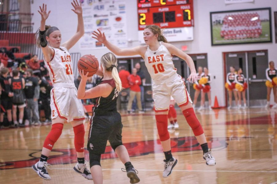 Attempting to block the pass, senior Caroline Scott and sophomore Emma Egan jump up to try to take possession of the ball. Despite the Lady Chargers blowing out the Lady Cougars, the girls are always looking for ways to improve their offense and defense.