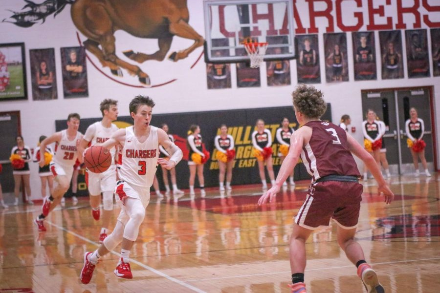 Senior Zak Perdew taking the ball down the court hoping to score. Perdew led the team this game with a total of 23 points, and a final score of 52-45.