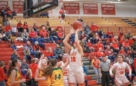 Getting ready to shoot a basket, sophomore Emma Egan scores another goal during their blow out against North Bullitt. However, it is not new for the Lady Chargers to blow out the opposing team.
