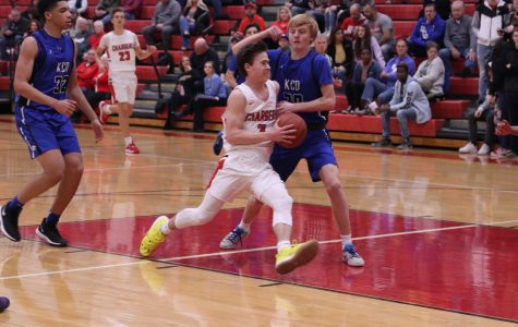 Senior Zak Perdew drives the ball to the basket during the Kentucky Country Day game. The Chargers won this game 81-52. Maki said,