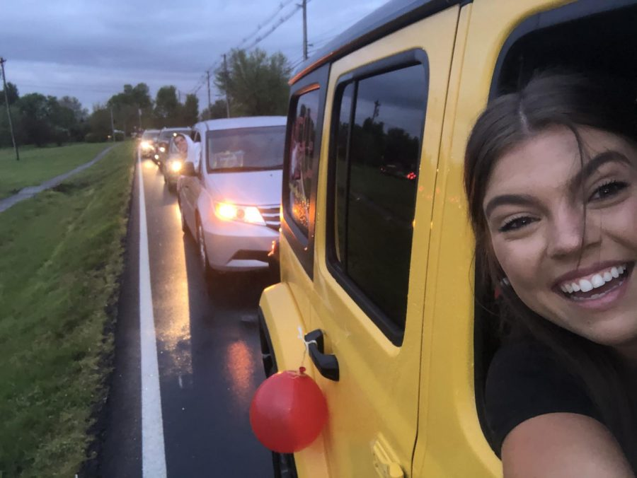 "Senior Meredith Bass, taking a selfie, in her car, at BE the Light. Apr. 23, 2020, an event was held where seniors, and their families, could go to Bullitt East, and drive around their high school one last time, and Bass went there. ""I was completely not expecting to be so emotional until the music came on, it added to everything and the teacher messages were amazing. It was really hard to see the baseball team so upset about their pregame song and jerseys hung up. I don't think it had really sunk in that i was going to be saying goodbye to BE, so when it hit it was really hard. It wasn't the send off we expected but our faculty and administrators really went above and beyond to make it special and I am so thankful for that,"" said Bass, ""I would drive through it 1000 times. I love Bullitt East, and it was filled with everything I love about it."""