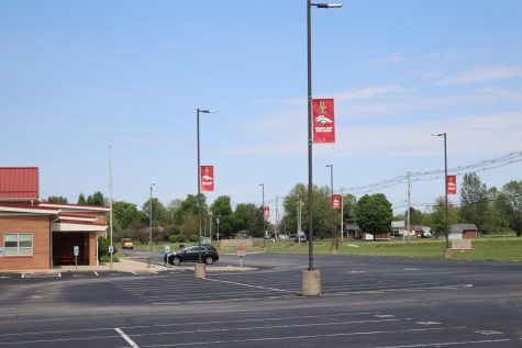 The empty school parking, where many seniors left on March 13 and couldnt return until their drive by.