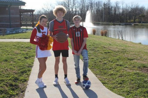 Jordyn Hawkins (left), Andrew Jackson (center), and Colton Jackson (right) wearing their team uniforms at Mount Washington Park.