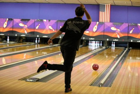 "Senior Adam Young bowling, to pick up the spare. Young had to step into the big shoes today, to fill the shoes of the two seniors, from last year. """"I mean, it might be better. A lot of people expect me to do better, because we lost seniors last year; the two best players, last year. They expect me to step it up, and try to get it done, and that is what I'm going to try to do,"" Young said."