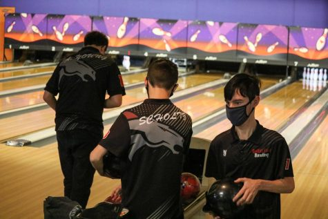"""Senior Adam Young, junior Austin Hale, and sophomore David Scholtz, all getting ready to bowl, from the Jan. 29 North Bullitt match. These are three of the key, and main, players, from the bowling team. Young plans to become better at bowling by, """"Just getting in the alley, and practicing more,"""" Young said."""