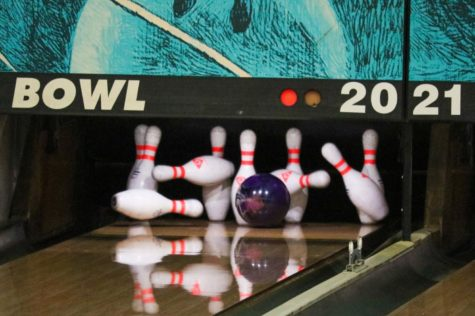 """Bowling ball going into the pins under the numbers: 2021. The 2021 season for this year's bowling team went pretty good, for senior Adam Young, in his opinion, for this being his last year on the team. """"I'm going to miss competing in these kinds of tournaments, and playing with all these good kids. I"""