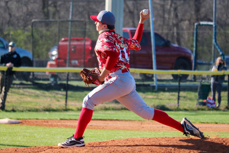 """Senior Brock Hammond pitching a ball during their first game of the season. The first game of the season was a game against Christian Academy. """"It"""