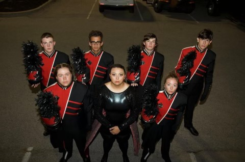Marching Band seniors pose for photo at their first competition of the season. They are looking forward to continuing on the season and seeing where it takes them.