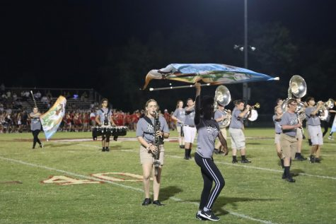 The Marching Band performing their show at half time during the home game  against Bullitt Central.