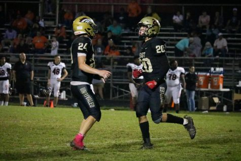 """Junior Nolan Davenport celebrating touchdown during the third quarter. Bullitt East faced Fern Creek Oct. 8, and won for the first time in two years, 20-6. """"We played pretty well. Our defense was shutting them down, and our offense did what they had to do to win the game,"""" Davenport said."""