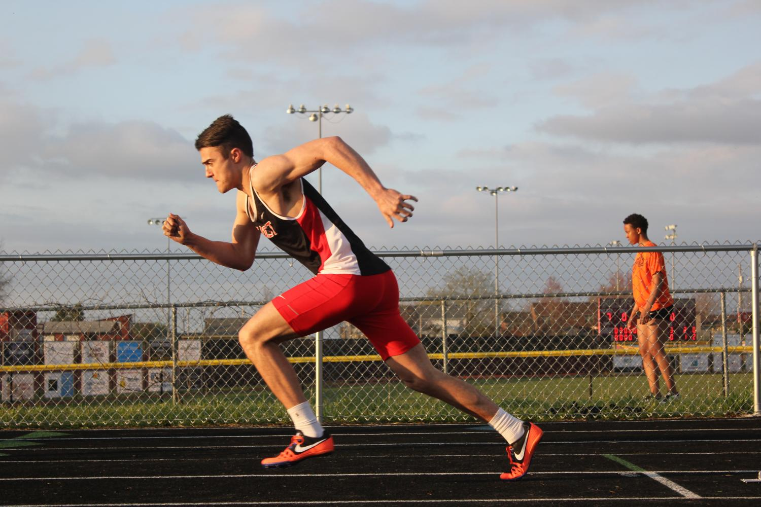 Senior Connor Green running in the boys 400 meter dash at Bullitt East. Photo: Haley Grether