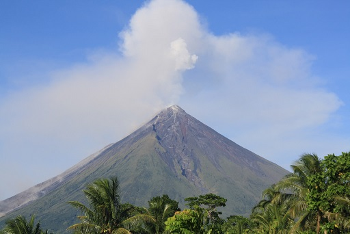Ash shoots out of Mount Mayon Volcano as it began erupting.