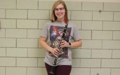 Wind ensemble member Patience Robinson poses with her clarinet.