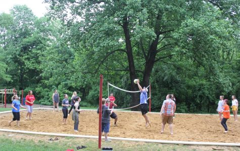 Attendees make use of the Bardstown Community Park's volleyball court during the annual choir picnic.