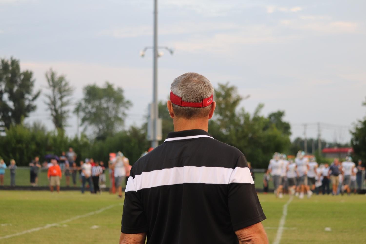 Coach Sander, along the sidelines, at the home game against Central Hardin.