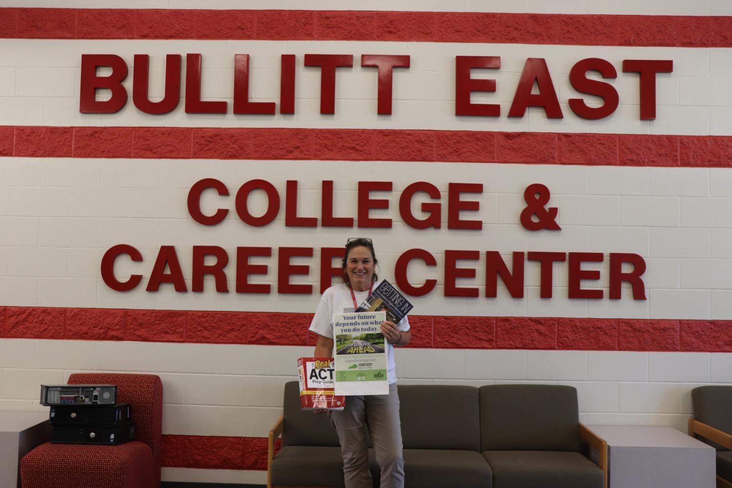 Here is Wendy McCutcheon, College and Career Readiness Director at Bullitt East, holding three helpful sources for students to become college- or career-ready or to explore their options regarding their college or career. This program aims to help students prepare for transitioning into whichever postsecondary education or career they choose, withstanding the new changes that have been made in Kentucky for the college and career readiness criteria.