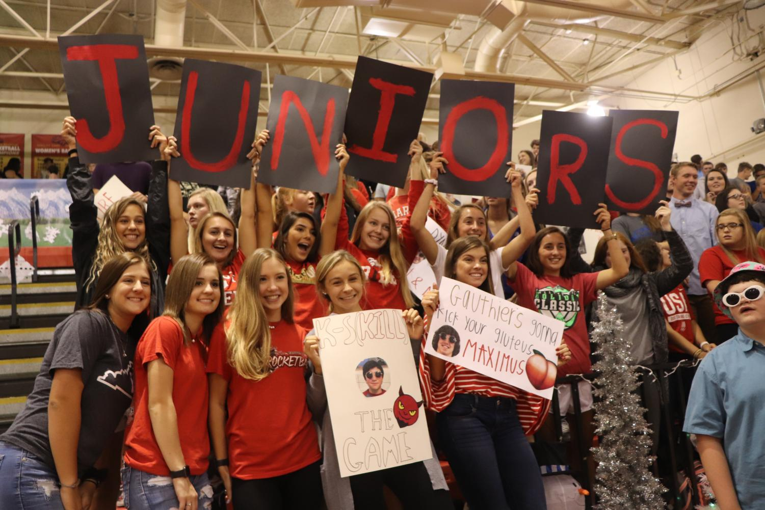 Juniors cheer on the rocketball players with several posters.