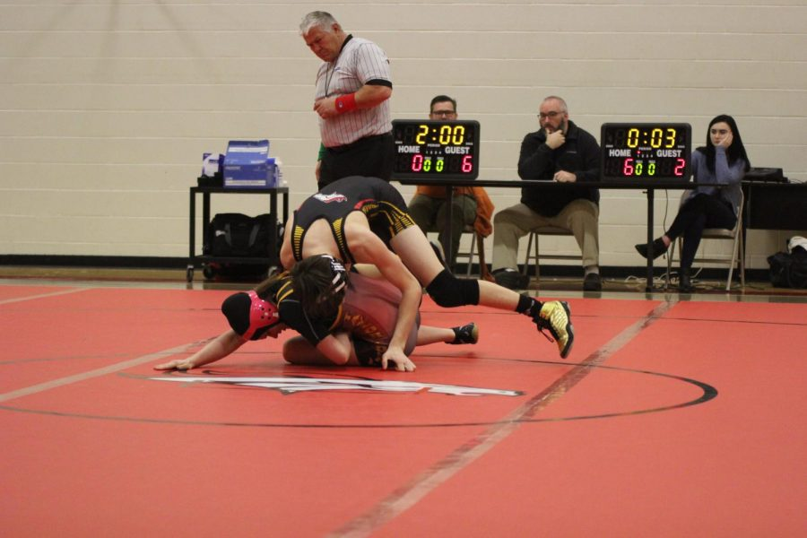 Sophomore Matthew Hendricks, a member of the wrestling team, beats Taylor County High School as the second competitor during the home match on Jan. 9. Contributions like his and other members of the team who have been putting forth a relentless effort to strengthen their wrestling skills are the main sources of the team's improvement from last year; if the effort continues, the team will be much more likely to finally achieve the end-of-season goals that have been desired by them for many years.