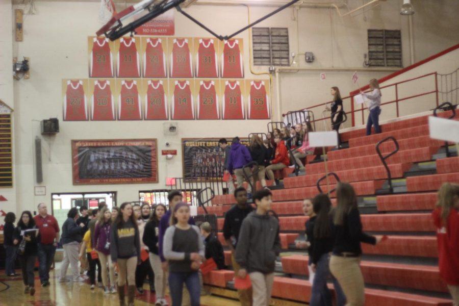 Eight grade students walking in to visit Bullitt East.