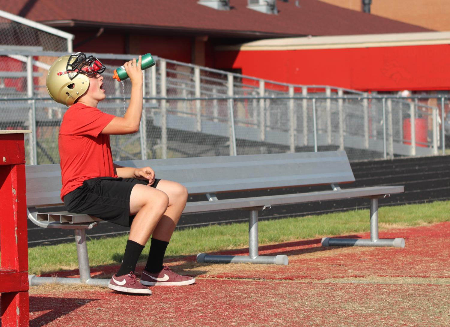 After a two hour practice, sophomore Ethan Taipalus takes a water break. The football coaches have stressed the idea of proper hydration this season due to dehydration issues in the past.