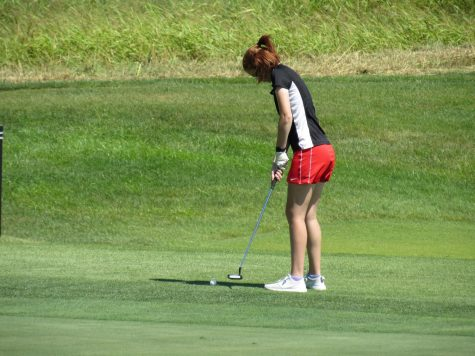 "Putting the golf ball, senior Abi Huffman about to make her final shot into the hole. On Aug. 24 the girls golf team competed in a tournament at their home course, Heritage Hill. ""Our scores all went down which is really good,"" said Huffman."