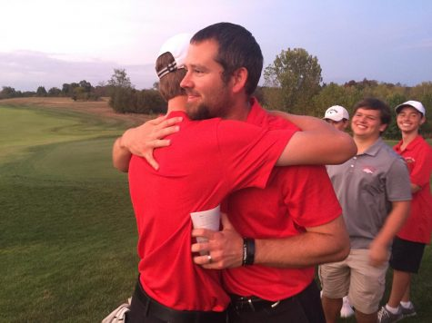 "Coach Kyle Downs and Senior Aiden Robison hugging. Robison, the team, and Downs all got emotional after Robison's last match ever, and Downs decided to comfort Robison by hugging him. ""I met Downs in fifth grade, and I've known him for a very long time,"" said Robison, ""I would not be the person I am, if I was not on this team, and Downs had a big help in making me the person I am today."""